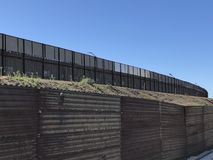 US - Mexican border wall in San Diego, CA. The USA Mexican border. The international border separating Mexico and the United States. The most frequently crossed royalty free stock photos