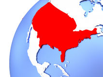 USA on modern shiny globe. Map of USA in red on elegant modern metallic globe. 3D illustration Stock Photo