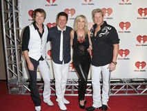 USA - Music - 2011 iHeartRadio Music Festival. LAS VEGAS - SEPTEMBER 24: Natasha Bedingfield appears with Rascal Flatts on the red carpet at the 2011 iHeartRadio Stock Photography