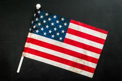 USA national day background with flag on black desk top view. Symbol of Independence. USA national day background with flag on black desk top view royalty free stock photos