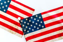 USA national day background with flag on white desk top view. Symbol of Independence. USA national day background with flag on white desk top view royalty free stock image
