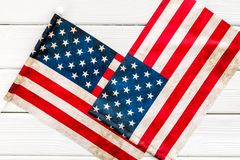 USA national day background with flag on white wooden desk top view. Symbol of Independence. USA national day background with flag on white wooden desk top view stock image