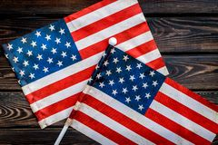 USA national day background with flag on wooden desk top view. Symbol of Independence. USA national day background with flag on wooden desk top view stock photography