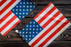 USA national day background with flag on wooden desk top view. Symbol of Independence. USA national day background with flag on wooden desk top view royalty free stock images
