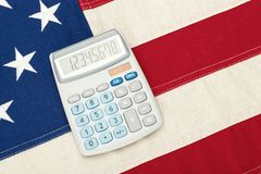 USA National flag with calculator over it royalty free stock photo
