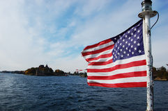 USA National Flag on St. Lawrence river, NY, USA Royalty Free Stock Images