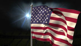 USA national flag waving on flagpole. On black background with flashing lights stock video