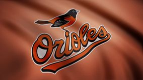 USA - NEW YORK, 12 August 2018: Waving flag with Baltimore Orioles professional team logo. Close-up of waving flag with. Waving flag with Baltimore Orioles stock photography