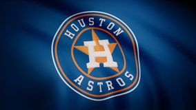 USA - NEW YORK, 12 August 2018: Waving flag with Houston Astros professional team logo. Close-up of waving flag with