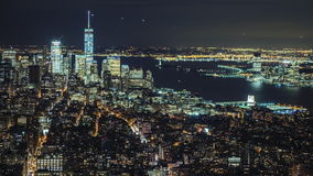 USA, New York City, Manhattan aerial panorama cityscape skyline. Lights of the city at night, traffic of cars, planes stock video