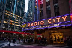 New York, Broadway streets at night. Radio city entrance, colorful neon lights. USA, New York, Manhattan. May 3, 2019. Radio city music hall entrance, colorful royalty free stock photo