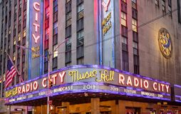New York, Broadway streets at night. Radio city entrance, colorful neon lights. USA, New York, Manhattan. May 3, 2019. Radio city music hall entrance, colorful royalty free stock images