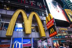New York, Broadway streets at night. Mc Donalds entrance, colorful neon lights. USA, New York, Manhattan. May 5, 2019. Times square Mc Donalds restaurant royalty free stock photos
