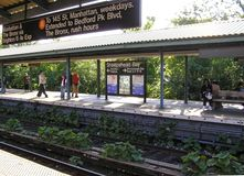 USA, New York. People are waiting for the train at the metro station Sheepshead bay. In Brooklyn fine autumn sunny day stock images