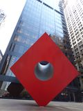 USA. New-York. Zuccotti Park. Red Cube. Red Cube by artist Isamu Noguchi Following the attacks of 11.09.2001, the park is covered with debris and is used as a stock images