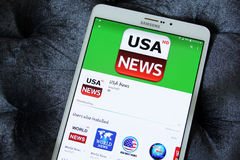 Usa news app. Downloading usa news application from google play store on samsung tab s2 stock images