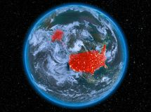 USA at night on Earth. Night view of USA highlighted in red on planet Earth with atmosphere and clouds. 3D illustration. Elements of this image furnished by NASA royalty free stock image