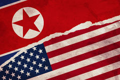 USA and North Korea flag. Painted on old grunge paper Royalty Free Stock Images