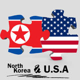 USA and North Korea flags in puzzle Royalty Free Stock Photo