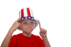 USA number one. Boy point to his USA hat while gesturing number one Royalty Free Stock Images