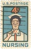 USA Nursing 4 Cent Stamp. USA four cent stamp featuring a nurse Stock Photos