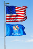 USA and Oklahoma Flags. With blue sky background Stock Photo