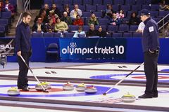 USA Olympic Men's Curling Team. Jason Smith (L) and John Shuster (R) consider possible strategies for Team John Shuster during the men's final match in the US Stock Photography