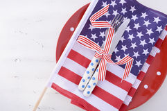 USA party table place setting with flag on white wood table. Stock Photography