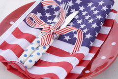 USA party table place setting with flag on white wood table. Stock Photo