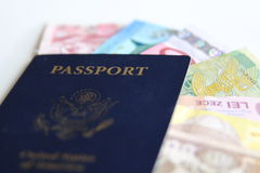USA passport and international currencies Royalty Free Stock Photo