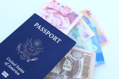 USA passport and multinational currencies Royalty Free Stock Photography