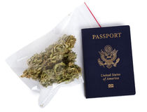 Smuggling Marijuana. A USA passport and a zip-lock plastic bag containing marijuna buds isolated on white background Stock Photography