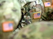 USA patch flag on soldiers arm. US troops.  stock photo
