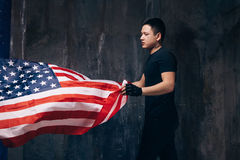 USA patriot with flying national flag and tattoo Stock Images