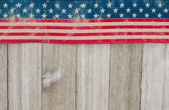 USA patriotic old flag on a weathered wood background Royalty Free Stock Image