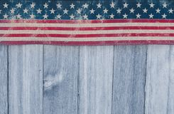 USA patriotic old flag on a weathered wood background Stock Photo