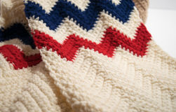 USA Patriotic scarf in single crochet stitches. Red, white and blue - USA Patriotic scarf in single crochet stitches using a chevron, zig zag, pattern Stock Images