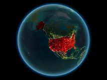 USA on planet Earth from space at night. USA in red with visible country borders and city lights from space at night. 3D illustration. Elements of this image royalty free stock image
