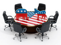 USA Political party symbols standing on American flag covered table Royalty Free Stock Photo