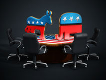 USA Political party symbols standing on American flag covered table Royalty Free Stock Images