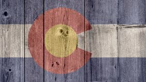 US State Colorado Flag Wooden Fence. USA Politics News Concept: US State Colorado Flag Wooden Fence stock photography