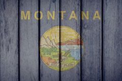 US State Montana Flag Wooden Fence royalty free stock images