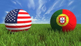 USA-Portugal. 3D soccer balls with usa and portugal flag, world football cup 2014. Placed on 3d grass. Background isolated with clipping path Royalty Free Stock Photo