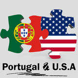 USA and Portugal flags in puzzle Royalty Free Stock Photo
