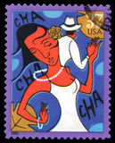 USA Postage Stamp Cha Cha. London, UK, July 30 2014 - Vintage 2005 United States of America cancelled postage stamp showing an abstract image of a couple dancing Royalty Free Stock Photos