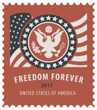 USA postage stamp with the eagle and american flag Stock Photo