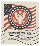 USA postage stamp with the eagle and american flag Royalty Free Stock Photos