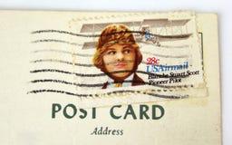 USA postage stamp on postcard. Closeup Stock Images