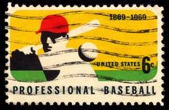 USA postage stamp professional baseball. USA vintage postage stamp with an image of a professional baseball player striking a ball Stock Images