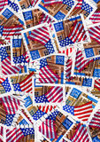 Usa postage stamps - flags. Used US Postage Stamps for background with american flags Royalty Free Stock Image